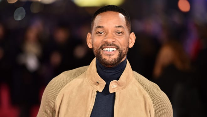 Will Smith poses for photographers ahead of the Special Screening of 'Focus' in central London on February 11, 2015.