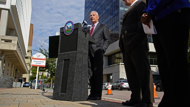 Wilmington Mayor Mike Purzycki speaks at a press conference with Finance Director Patrick Carter in October.