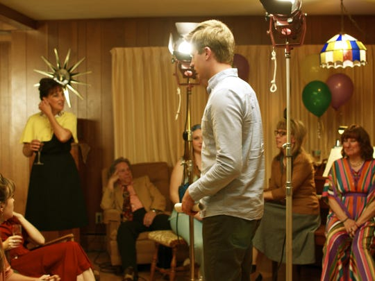 "Director Drew Britton works with local actors Carrie Counihan, Bill Bauernfeind, Keri Grimsley, Laura Vlies and Renee Kujawski, from left, in a scene from ""Richard's 32nd,"" which was shot in Door County and is premiering at the Short Film Corner at this year's Cannes Film Festival in France."