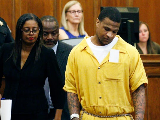 "Quinton Tellis reacts after one of his attorneys, Darla Palmer, left, pleads ""not guilty""on his behalf at DeSoto County Courthouse on July 15, 2016, in Hernando, Miss. Panola County District Attorney John Champion said charging Tellis ended a lengthy investigation into the grisly burning death of the 19-year-old, who died in a Memphis, Tenn., hospital hours after being found near her burned-out vehicle on a road not far from her home."