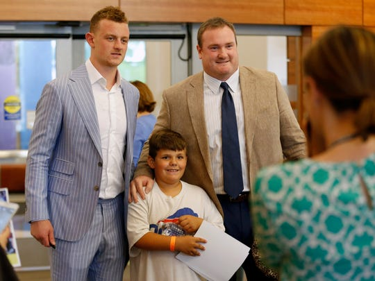 Buffalo Sabres center Jack Eichel and Kyle Williams of theBuffalo Bills pose with Jake Carbone, 10, of Greece while visiting patients and their families Wednesday at University of Rochester Medicine's Golisano Children's Hospital.