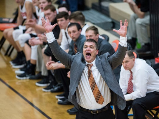 North Daviess head coach Brent Dalrymple yells at his team from the the bench at North Daviess High School on Thursday, Feb. 16, 2018. North Daviess defeated White River Valley 38-23.