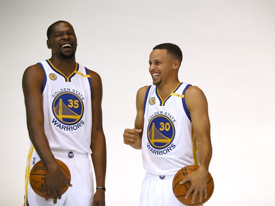 Kevin Durant and Stephen Curry joke around while they