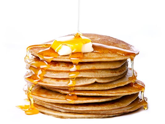 Small pancakes with butter and honey