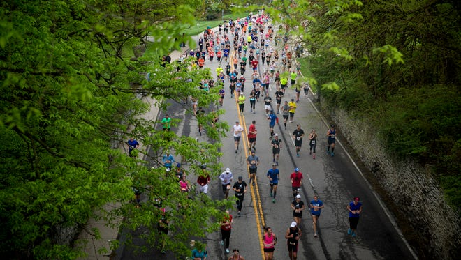 Runners climb the hill to Eden Park during the 20th annual Flying Pig Marathon Sunday, May 6, 2018. More than 40,000 people registered for the Flying Pig Marathon events.