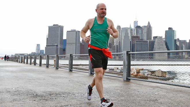 Rupert Warwick, visiting from Great Britain, runs along the waterfront in Brooklyn Bridge Park on Dec. 24, 2015. Warwick said temperatures as warm as this were not unusual at his home in the south of England this time of year, but he came to New York for a more typical, cold and wintry Christmas.