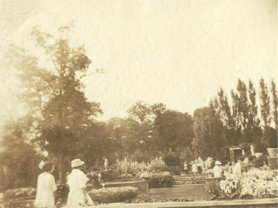 Visitors to the formal gardens at Shelburne Farms, circa 1925.