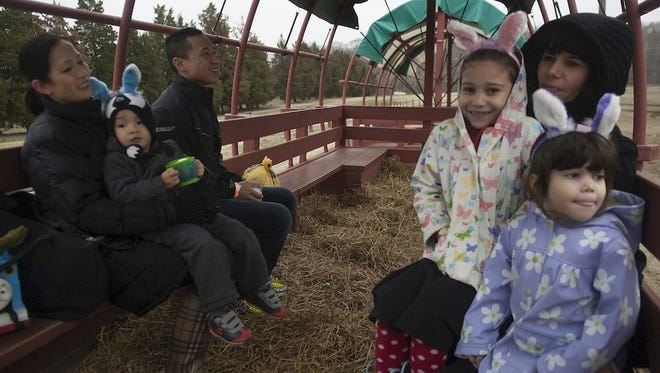 Visitors to Johnson's Corner Farm enjoy an egg hunt hayride