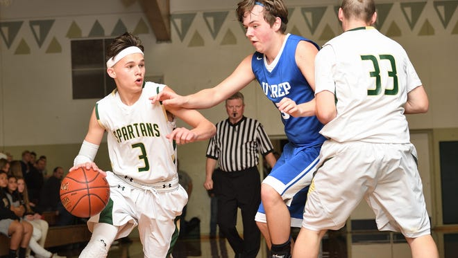 Red Bluff High's Brayden Hutchins (left) dribbles the ball around U-Prep's Eddy Gilmette and teammate (center) Payton Edwards Thursday night in the Holiday Classic. Red Bluff won 49-48.