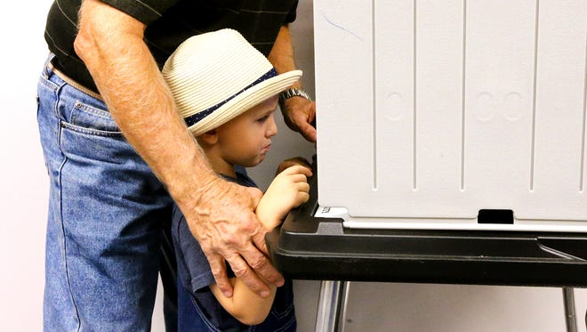 Mason Rowland, 3 goes to early vote with his grandfather Doye Rowland, on the first day of early voting in Murfreesboro, on Wednesday, Oct. 19, 2016.