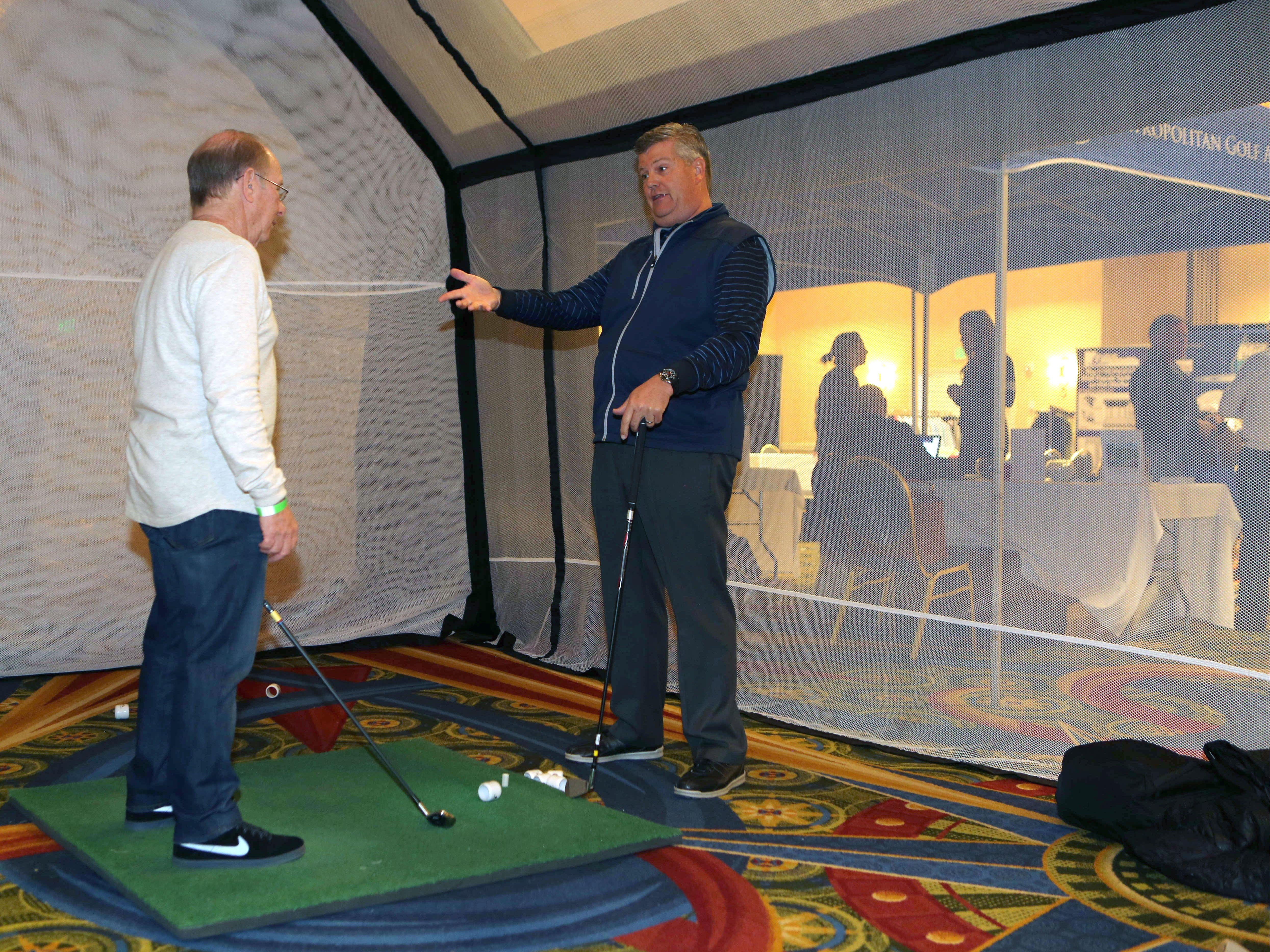 Bill Smittle, right, the head golf pro at Scarsdale Golf Club, gives tips to Ken Weisberger from White Plains, at the lohud.com Golf Show at the Westchester Marriott in Tarrytown, March 12, 2016. The show continues Sunday, March 13, 2016 from 9:00 a.m. till 4:00 p.m.