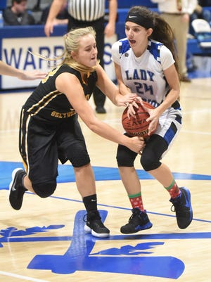 Cotter's Makayla Bramblett (right) battles a Sloan-Hendrix player for the ball during the Lady Warriors' 50-39 victory on Thursday night.
