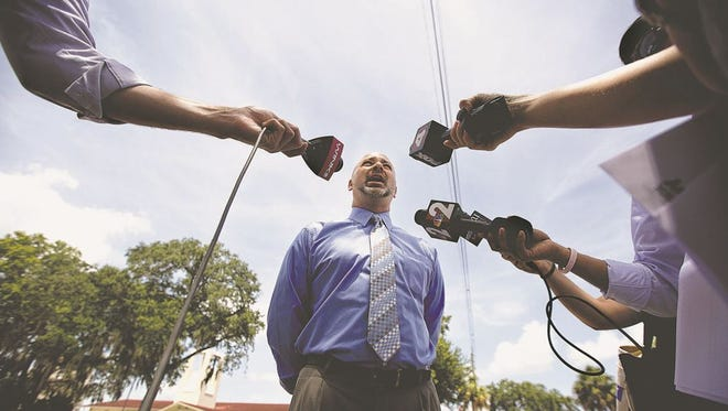 Attorney Adam Horowitz speaks Tuesday in front of St. Francis Xavier Church in Fort Myers on Tuesday. He announced a settlement between his client and the Diocese of Venice after a diocesan tribunal found former priest Jean Ronald Joseph guilty of sexual misconduct against a child.