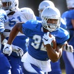 I'Tavius Mathers runs the ball, during MTSU's football practice, on Tuesday March 22, 2016.
