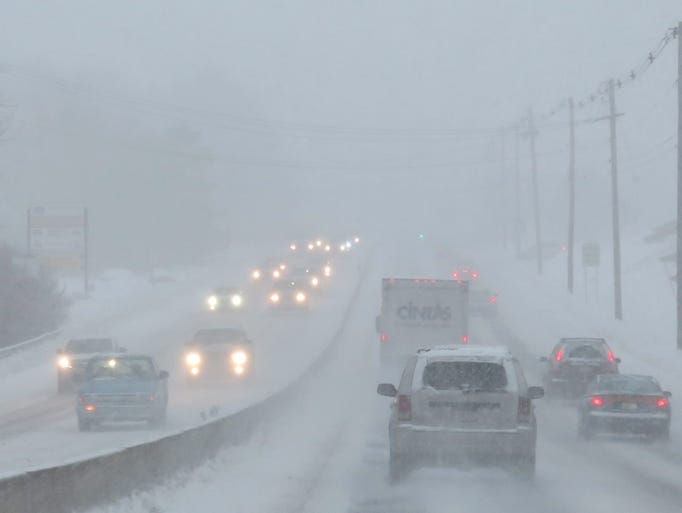 Traffic on Route 1 moves slowly in heavy snowfall as a second snowstorm hits Walpole, Mass.