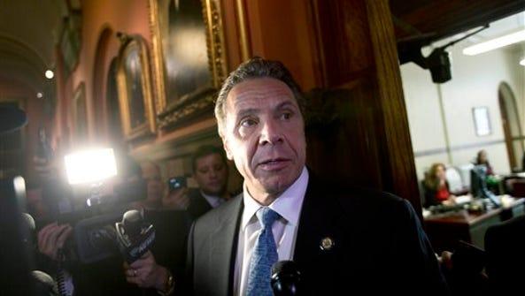 New York Gov. Andrew Cuomo talks to media  outside