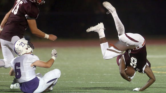 Harrison's Brian Newsmen tumbles after bring hit by