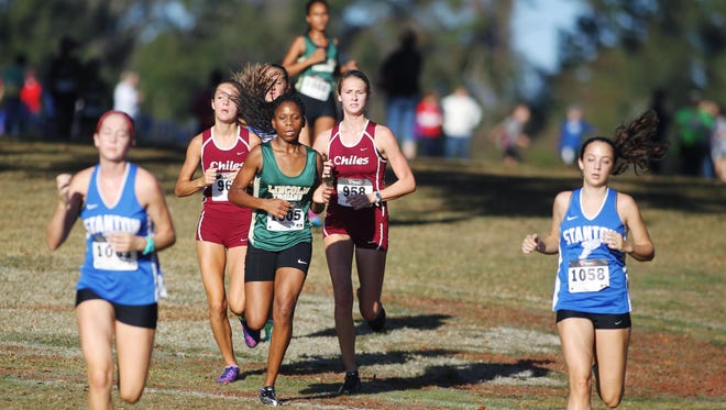 Chiles sophomores Olivia Miller, left, and Lawton Campbell run during last year's district meet at Apalachee Regional Park.