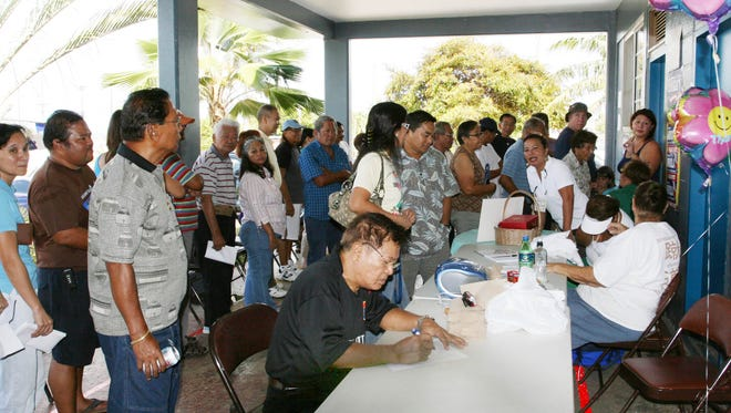 In this 2008 file photo, Guam Democrats turned out in droves to vote in the party caucus in Dededo. The party's caucus this year is scheduled for May 7. The island's Republican Party is scheduled to meet Saturday to select delegates to the GOP national convention.