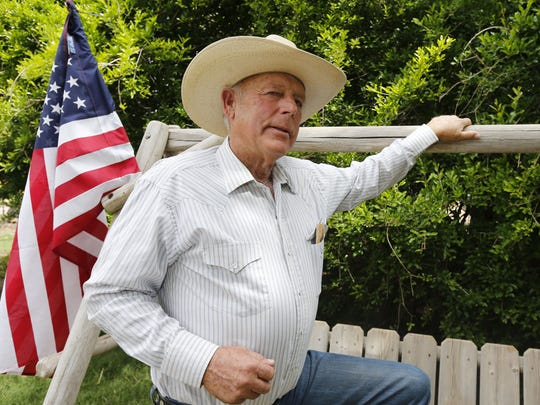 File photo from 2014: Rancher Cliven Bundy poses for a photo outside his ranch house west of Mesquite, Nevada.