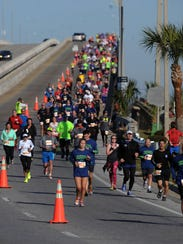 Runners come over the Bob Sikes Bridge Saturday morning