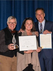 Sparky and Peggy Potter accept the Governor's Award