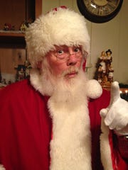 Jim Updike, 55, Carmel, has been playing Santa Claus for three years.
