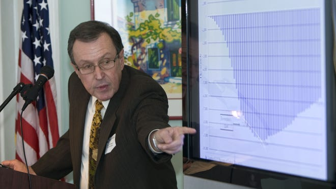 New Jersey Bankers Association and the Edward J. Bloustein School of Planning and Public Policy at Rutgers University have released the results of the sixth annual Economic Survey of Bank CEOs James Hughes, dean of the Bloustein School, points to a graph at a previous presentation of the survey.