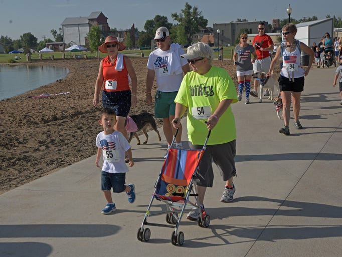 Participants show their patriotism by participating in the 4th of July four legged run/walk around Boardwalk Park and Windsor Lake.  The race was the first of several events during the day sponsored by the Town of Windsor Parks and Recreation Department.