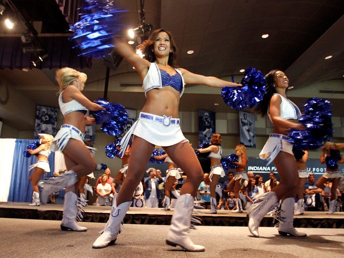 Cheerleaders dance in the new uniforms at the Indianapolis Colts cheerleaders calendar and uniform release party at the Indiana Farm Bureau Football Center in Indianapolis on Friday, July 25, 2014. The new uniform design is the first upgrade in ten seasons.