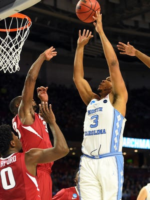 North Carolina Tar Heels forward Kennedy Meeks (3) shoots the ball against Arkansas Razorbacks forward Moses Kingsley (33) during the first half in the second round of the 2017 NCAA tournament at Bon Secours Wellness Arena.