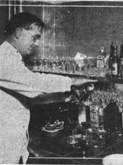 Bartender Frank Holleran resumes his job in the bar