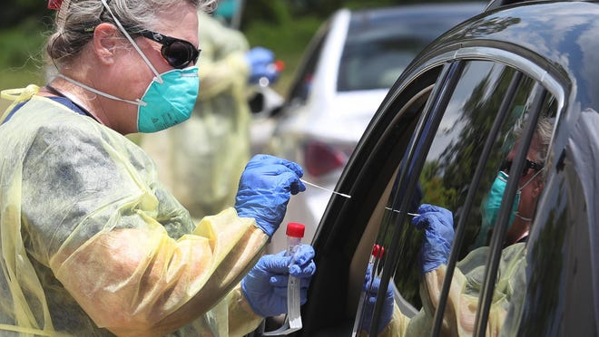 Drive-thru testing continued Thursday at Chisholm Elementary School in New Smyrna Beach. Also on Thursday, the state announced a record-high number of 3,207 new coronavirus cases, with Volusia County reporting its highest number of new cases at 62.