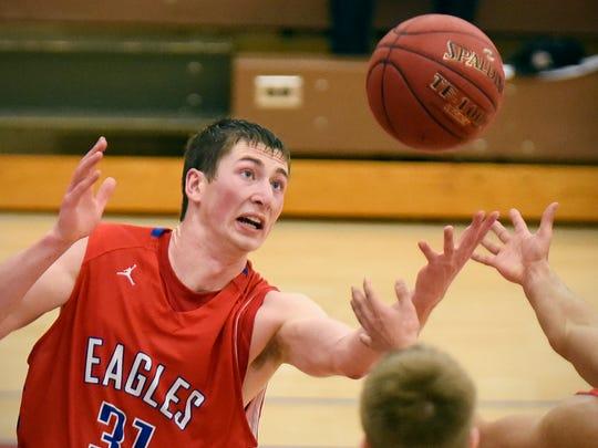 Apollo's Ethan Novacinski tries to get a rebound under