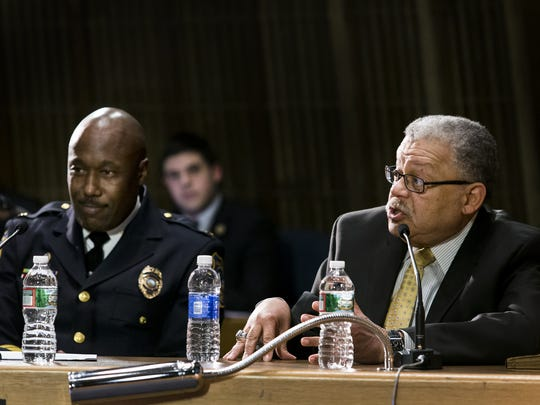 Charles Ramsey (right) addresses members of the Wilmington City Council in February 2016. On the left is Police Chief Bobby Cummings.