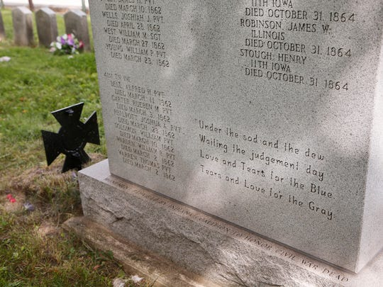 A monument honoring both Union and Confederate soldiers from the Civil War buried in Greenbush Cemetery Friday, August 18, 2017, in Lafayette.