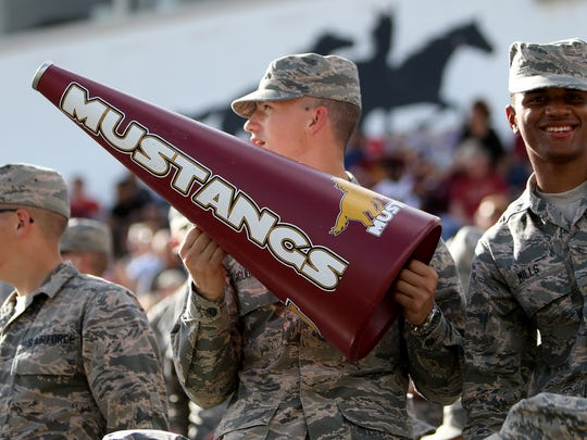 An airmen holds a Midwestern State megaphone while watching the Mustangs play against Tarleton State Saturday, Nov. 4, 2017, at Memorial Stadium in Wichita Falls.