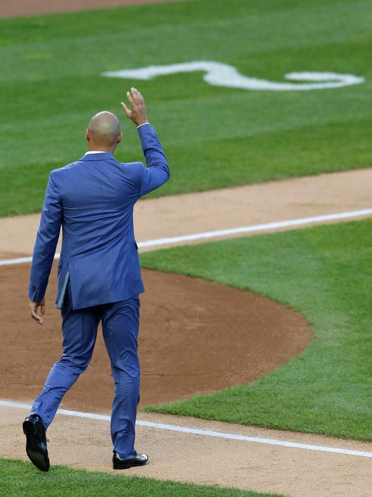 Former New York Yankees' Derek Jeter waves to the crowd during a ceremony retiring his number at Yankee Stadium, Sunday, May 14, 2017, in New York. (AP Photo/Seth Wenig)