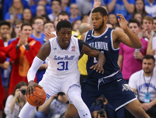 Seton Hall Pirates center Angel Delgado (31) fights