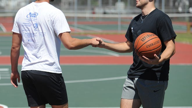 Hopedale's Dan Liberatore congratulates Bellingham's Tate Pike (right) on winning at the Daily News 3-point competition at Bowditch Field on Thursday. Pike beat Liberatore in the finals.