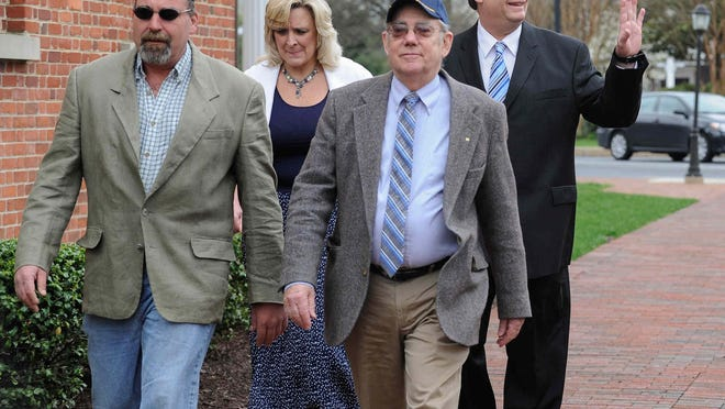 Eric Bodenweiser (back right) arrives for sentencing Friday morning at the Sussex County Courthouse with his wife Patty.