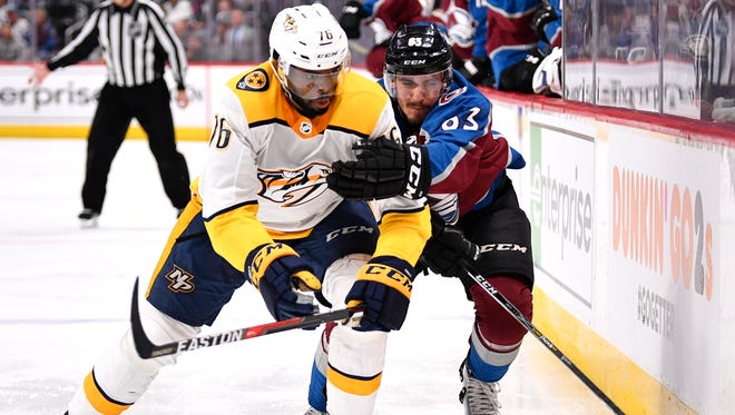 Nashville Predators defenseman P.K. Subban (76) and Colorado Avalanche left wing Matt Nieto (83) battle along the boards during the second period of game 6 in the first round NHL Stanley Cup Playoffs at Pepsi Center, Sunday, April 22, 2018, in Denver, Colo.