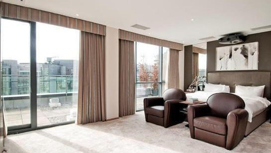 One of the bedrooms in the luxury penthouse in the London neighborhood of Paddington. The owners have a spare room available for free.
