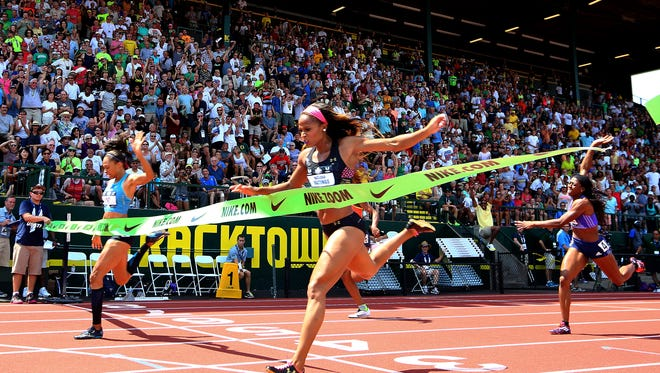 Allyson Felix, left, beats Natasha Hastings, right, in the women's 400 meters at the U.S. track and field championships in Eugene, Ore., Saturday, June 27, 2015.