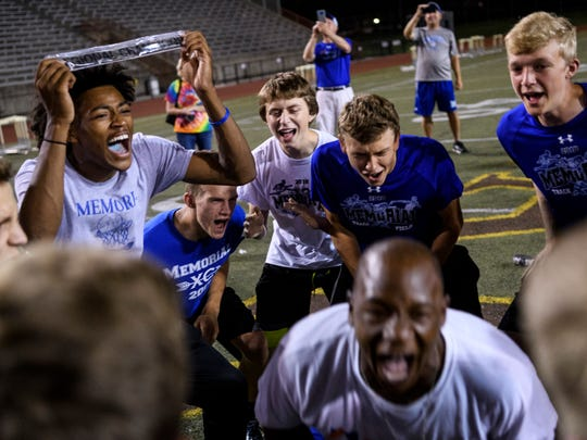 The Memorial Boys track and field team celebrates their regional title win at Central Stadium in Evansville, Ind., Thursday, May 24, 2018. The team won their first regional title in school history.