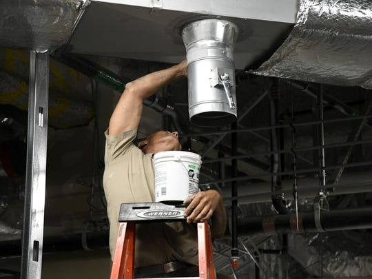 A construction worker seals a duct in zone 4 of the emergency department expansion at Kaweah Delta Medical Center.