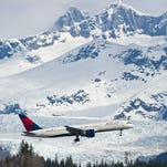 A Delta Air Lines Boeing 757 does a flyover of the Alaska's Juneau International Airport on April 16, 2014. The first scheduled flight by Delta to Juneau from Seattle began in May 2014.
