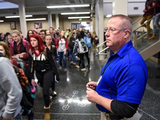 Sauk Rapids police officer Tim Sigler watches Tuesday,