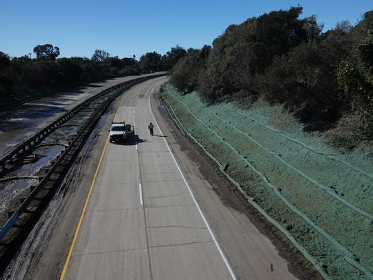 On Saturday afternoon, a Caltrans worker could be seen alone on the northbound lanes of Highway 101 from the Olive Mill Road overpass in Montecito. The freeway reopened Sunday afternoon after being shut since fatal mudslides hit Montecito on Jan. 9.