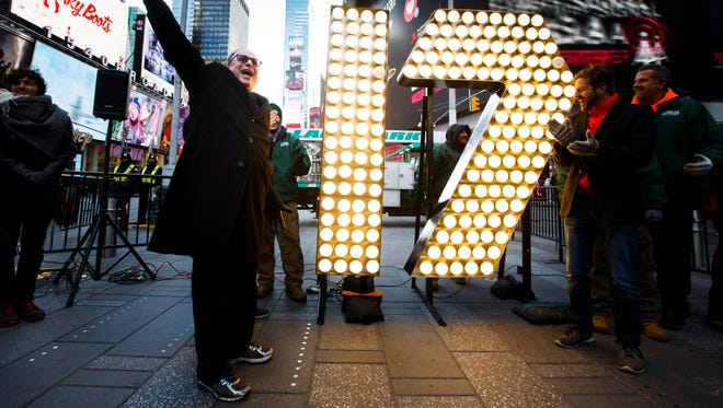 """Spear phishing"" will continue to be the Achilles' heel of cybersecurity in 2017. Here, Jeffrey Strauss of Countdown Entertainment gestures Friday as two giant numbers that will be used to illuminate the number '2017' above New Year's Eve in Times Square are illuminated."
